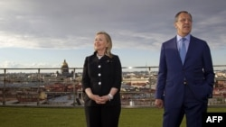 Russian Foreign Minister Sergei Lavrov (right) and U.S. Secretary of State Hillary, posing for photos in St. Petersburg back in June, say the new agreements are further proof of growing cooperation.