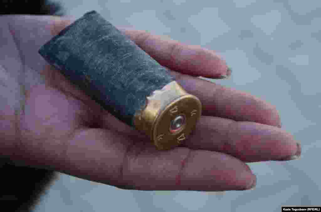 "Casing from a shotgun pellet. The Kazakh authorities have said the police were left ""with no choice but to shoot."""