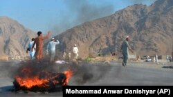 Men shout slogans against terrorists after a suicide attack among the protesters in Momandara district of Nangarhar Province on September 11.