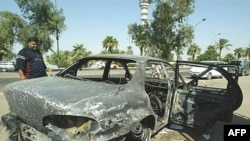 A burned-out car on the site where Blackwater guards who were escorting U.S. Embassy officials opened fire in the western Baghdad neighborhood of Yarmukh in September 2007.