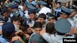 Armenia - Youth activists clash with riot police during a demonstration against eletricity price increases, Yerevan, 17Jun2015.