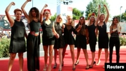 Director Kitty Green (fourth from the left) poses with members of the women's rights group Femen at the 70th Venice Film Festival.