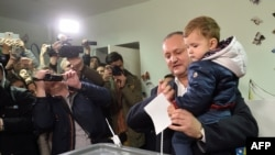 The presidential candidate of the Socialist Party of Moldova, Igor Dodon, votes at a polling station in Chisinau on October 30.