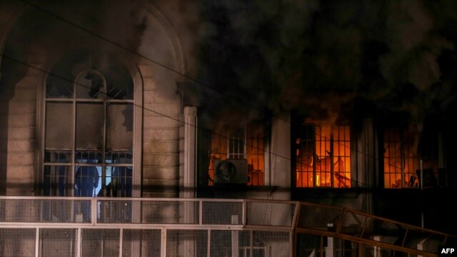 Iranian protesters set fire to the Saudi Embassy in Tehran during a demonstration against the execution of prominent Shi'ite Muslim cleric Nimr al-Nimr by Saudi authorities on January 2.