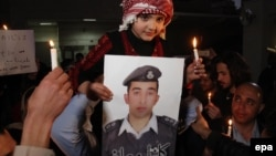 By a chilling coincidence, the young medical student-turned-suicide bomber hailed from Al-Karak, a province southwest of the Jordanian capital, Amman, that was also the home of Jordanian pilot Muath al-Kasasbeh (pictured,in photograph), who was burned alive by IS militants in February.