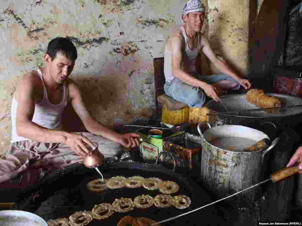 "Afghan bakers make the traditional sweet ""jalabi"" during the Islamic holy month of Ramadan in Kabul."