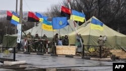 Ukrainian nationalist protesters and military veterans take part in the trade blockade at the Kryvyy Torets railway station last moth.