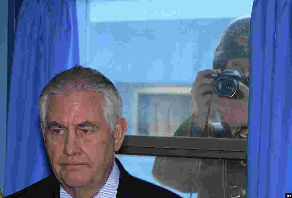 A North Korean soldier takes a picture of U.S. Secretary of State Rex Tillerson during his visit to Panmunjom, the truce village near the border between the two Koreas. Tillerson arrived in South Korea on a two-day visit as part of his three-country trip through the Asia-Pacific region. (epa/Yonhap)