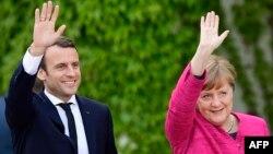 Емманюель Макрон і Анґела Меркель на зустрічі в Берліні, 15 травня 2017 року