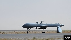 Afghanistan -- A US Predator unmanned drone armed with a missile sitting on the tarmac of Kandahar military airport, 13Jun2010