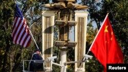 امریکا د چین پرلوړ پوړو چارواکي بندیزونه لګوي