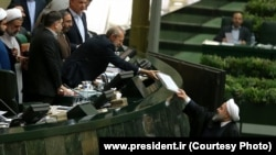 Iran: Hassan Rouhani , Iran`s President, gave next year budget to Ali Larijani , Speaker of parliament.