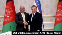 Afghan President Ashraf Ghani (left) shakes hands with his Uzbek counterpart, Shavkat Mirziyoev, in Tashkent on December 5.