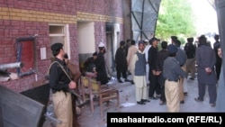 Pakistani police and security forces gather outside the prison in Bannu after the militant attack.