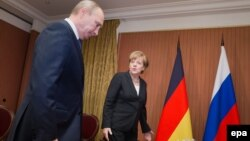 Володимир Путін та Анґела Меркель, червень 2014 року