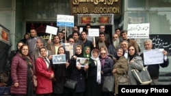 Nasrin Sotoudeh (center, holding flower) demonstrates in front of Iran's Bar Association last month along with a number of supporters.