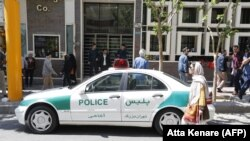 An Iranian police vehicle is seen parked outside a currency exchange shop in the capital Tehran, April 10, 2018
