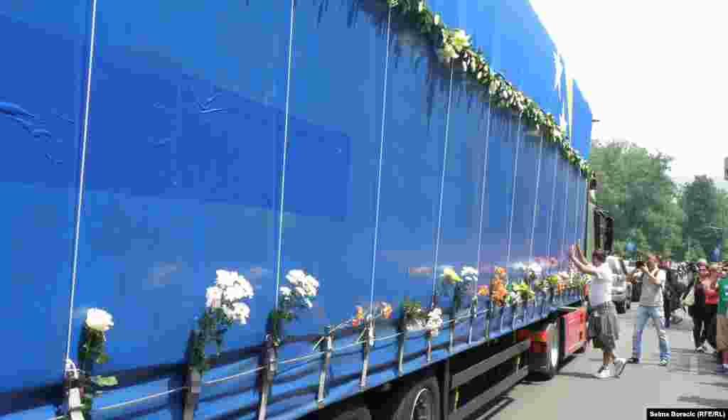 Flowers placed on the trucks by well-wishers.