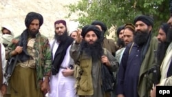 A video grab shows Mullah Fazlullah (C), the head of the Tehrik-e Taliban Pakistan (TTP) at an undisclosed location.