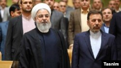 President Hassan Rouhani (left) with the head of presidential office, Mahmoud Vaezi, undated. FILE PHOTO