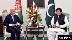 Afghan President Ashraf Ghani (left) met with Pakistani Prime Minister Imran Khan in Islamabad in June 2019.