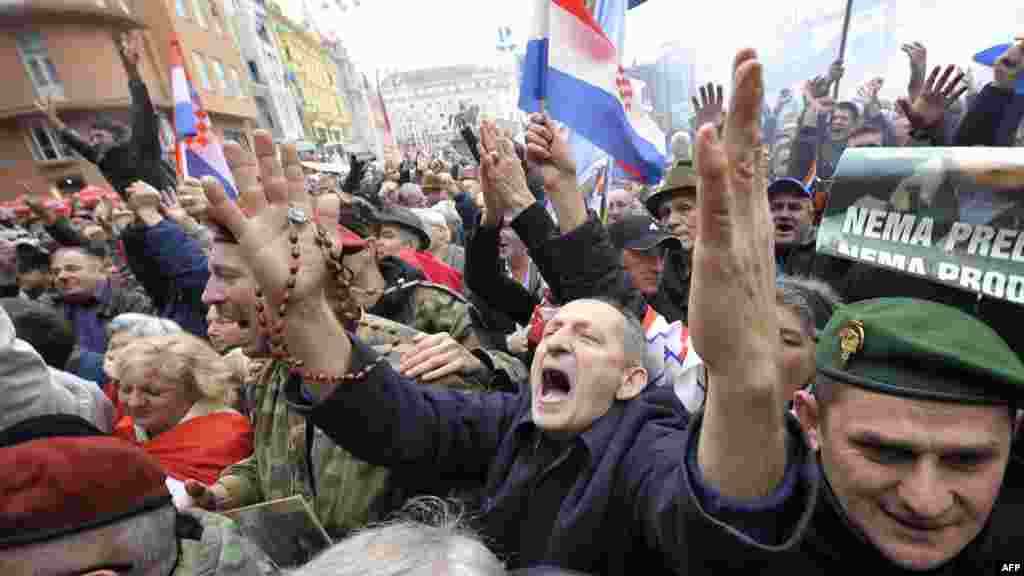People in Zagreb cheer seconds after the UN war crimes court announced the acquittal of former Croatian generals Ante Gotovina and Mladen Markac on charges including war crimes. (AFP/Hrvoje Polan)