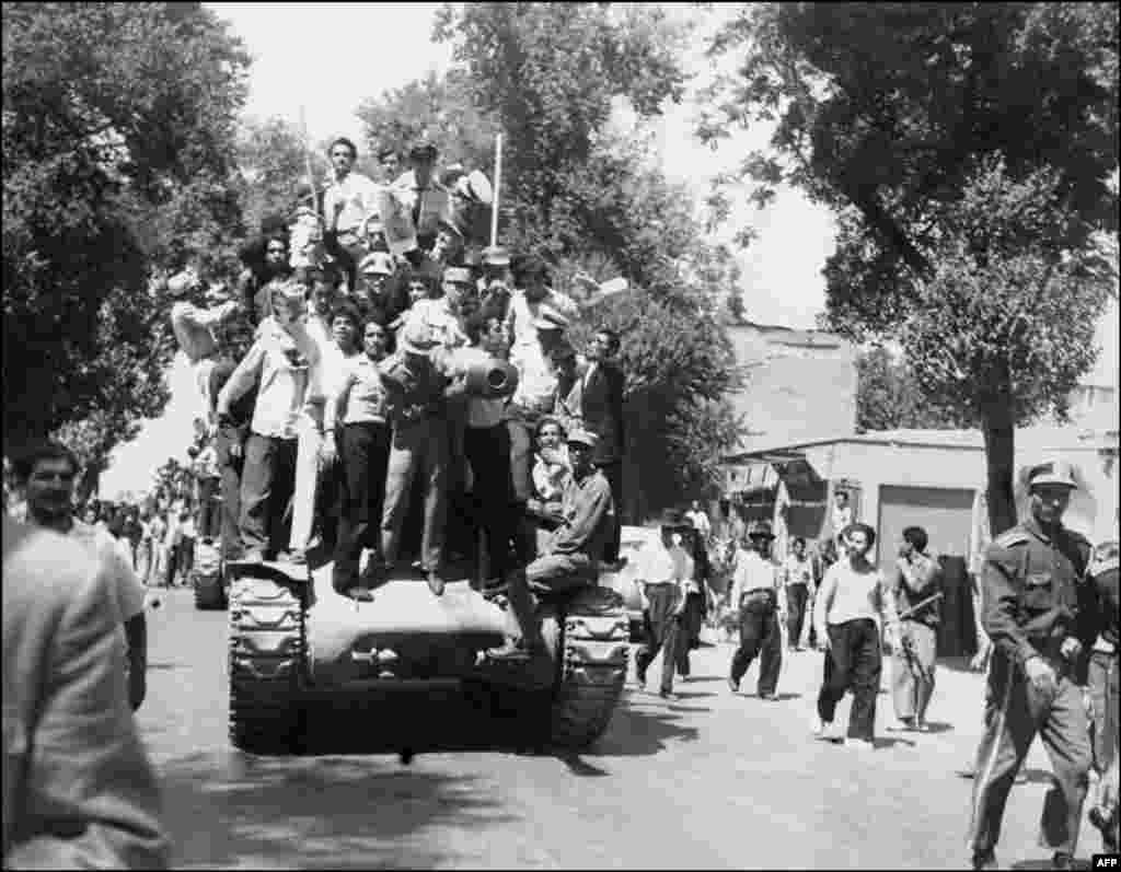 Iranian Army officers and supporters of the monarchy gather on August 27, shortly after the shah returned from a brief period of exile to reclaim power.
