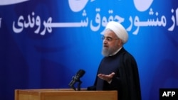 Iranian President Hassan Rohani gives a speech during a televised ceremony after he unveiled a landmark bill of rights in Tehran on December 19.