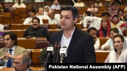 FILE: Hammad Azhar, Pakistan's minister of industries and production addressing the parliament in June 2019.