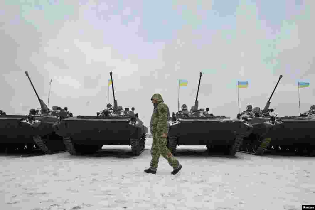 A Ukrainian serviceman walks past reconditioned armoured personnel carriers during a ceremony to hand over weapons, military equipment and aircrafts to the army at a firing range outside Zhytomyr on January 5. (Reuters/Valentyn Ogirenko)​