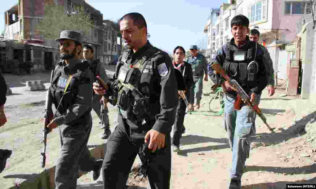 Police and security forces respond to the eruption of violence in Kabul on April 15. (Sayedjan Sabawoon/Radio Free Afghanistan)