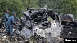 Emergency Situations Ministry personnel work at the scene of a bus crash in Siberia that left 11 people dead.