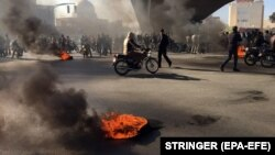 Iranian protesters block a highway amid angry protests against a fuel price increase, in Isfahan on November 16.