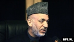 Afghan President Hamid Karzai speaks during an interview with RFE/RL in Kabul on November 1.