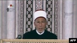 An image grab taken from state-run Syrian television on March 21 shows an archive video of senior cleric Muhammad al-Buti speaking during a religious ceremony at the historic Umayad Mosque in Damascus.