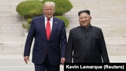 U.S. President Donald Trump (left) meets with North Korean leader Kim Jong Un at the demilitarized zone separating the two Koreas, in Panmunjom, South Korea, on June 30.
