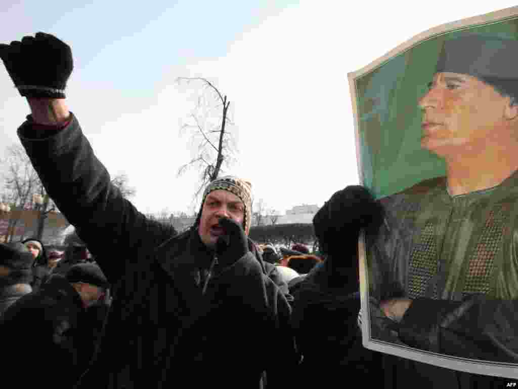 Russian Communist Party supporters shout as they hold a picture of Libyan leader Muammar Qaddafi during a rally devoted to the Defenders of the Fatherland Day holiday in Moscow on February 23. Photo by Aleksei Sazonov for AFP