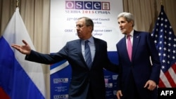 Serbia -- Russian Foreign Minister Sergei Lavrov (L) Russian Foreign Minister Sergei Lavrov (L) invites US Secretary of State John Kerry to a sitting area as he arrives for their bilateral meeting alongside the annual OSCE Ministerial Council meeting in B