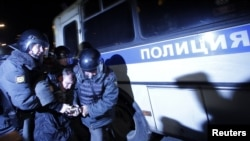 Police detain an activist during a rally to protest the results of the parliamentary elections in Moscow on December 6.