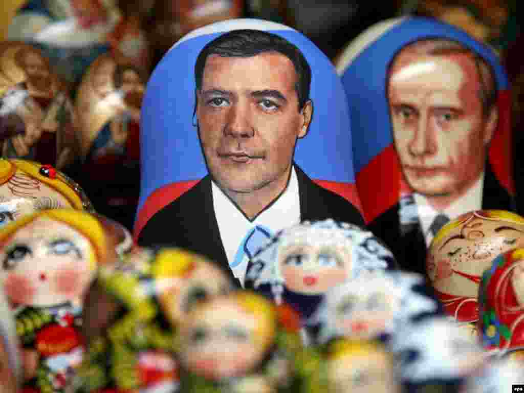 Nesting dolls bear the likenesses of Dmitry Medvedev and Vladimir Putin ahead of Russia's presidential election. - Matrioshka dolls whith the faces of Russian Deputy Prime Minister and presidential candidate Dmitry Medvedev (L) and Russian President Vladimir Putin (R) are displayed on the table of the street souvenir vendor in St.Petersburg.
