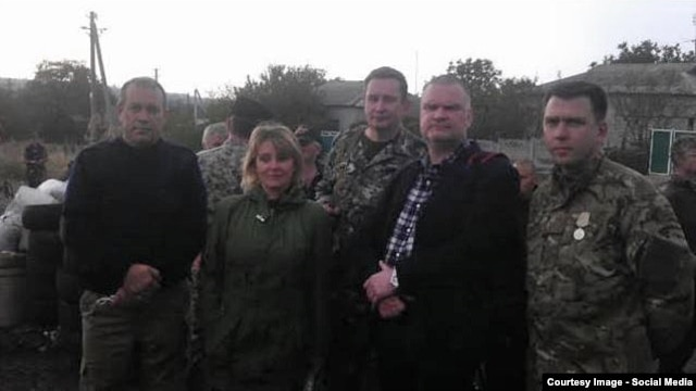 The OSCE says it has no record of having any link with Einars Graudins (second from right).