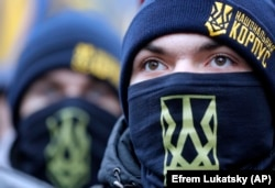 Members of the National Militia attend a rally in front of the Ukrainian president's office in Kyiv on December 7.