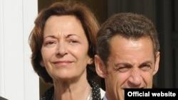 Fransiýanyň Daşary söwda boýunça döwlet sekretary Anne-Mariýe Idrak (çepde) we Fransiýanyň prezidenti Nikolýa Sarkozi, Brýussel, 2008-nji ýyl.