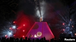 "A Mayan priest sits atop a pyramid as Richard Garriott addresses guests at his ""End of the World Soiree"" dress rehearsal in Austin, Texas."