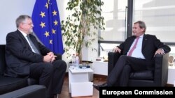 Belgium -- EU Enlargement Commissioner Johannes Hahn (R) meets with Herbert Salber, Designated EU Special Representative for the South Caucasus and for the crisis in Georgia, Brussels, November 13, 2014