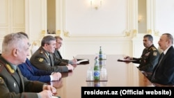 The chief of the General Staff of the Russian armed forces, General Valery Gerasimov, meets with Azerbaijani President Ilham Aliyev in Baku.