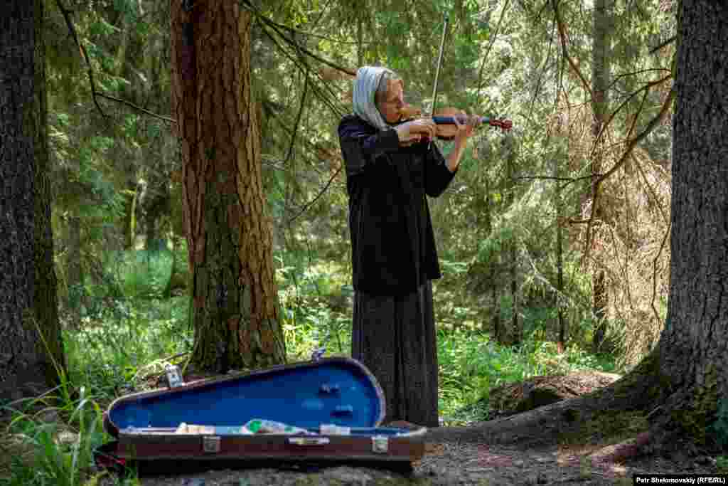Yelena plays violin for tourists and teaches music to the local monks. She moved to the island 31 years ago, but is also faced with eviction as the church reclaims its property.