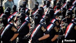 Члени іракських збройних сил на військовому параді, площа Тахрір, центр Багдада, Ірак, 14 липня 2016 року
