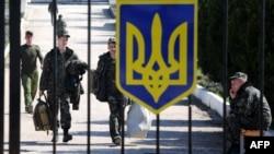 Ukrainian pilots leave the Belbek air base outside Sevastopol on March 21. Remaining troops now face a Russian ultimatum.