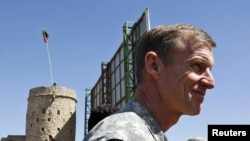 General Stanley McChrystal joined Hamid Karzai on the visit to reassure tribal leaders in Kandahar.